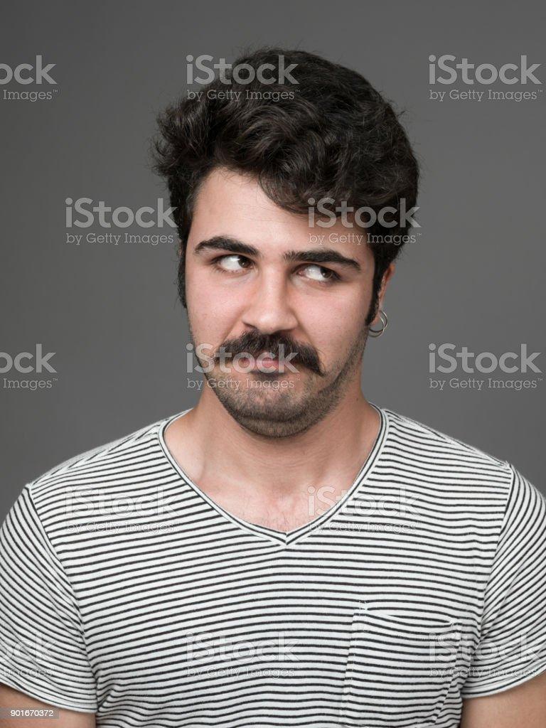 Mugshot Of Young Man Making A Face stock photo