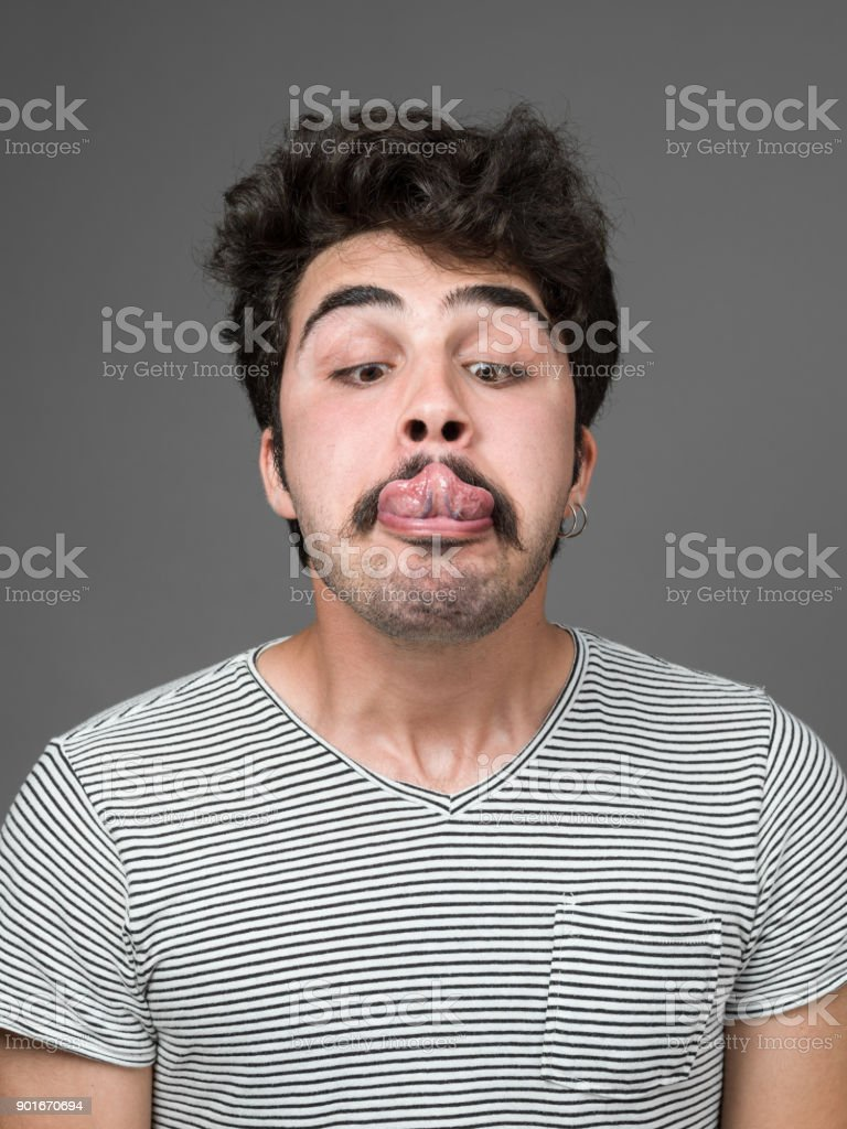 Mugshot Of Young Man Making A Face stock photo