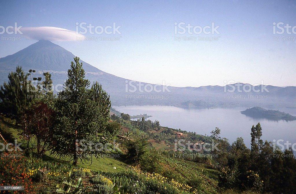 Muhabura Volcano with Cloud Cap and Lake Ruhondo Rwanda Africa stock photo