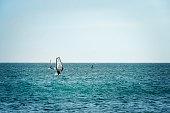 Mui Ne, Vietnam. Man play wind surfing sport in the sea under vast blue sky