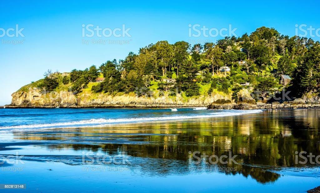 muir beach and reflections on pacific ocean coast near san francisco stock photo