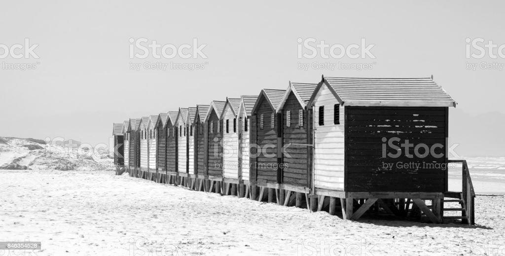Muizenberg beach huts Cape Town painted houses shoreline black white stock photo