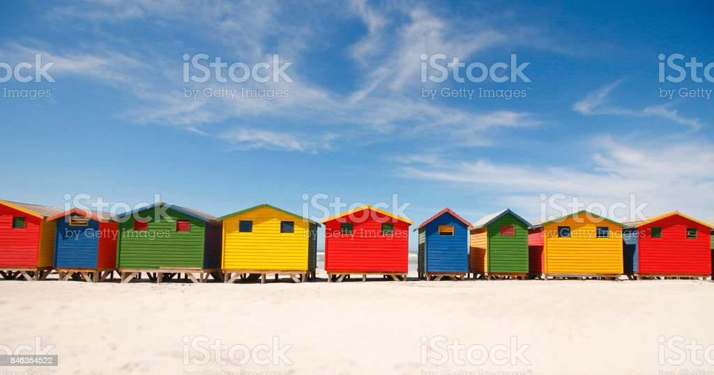 Muizenberg beach huts colorful painted wood houses South Africa shoreline ocean stock photo
