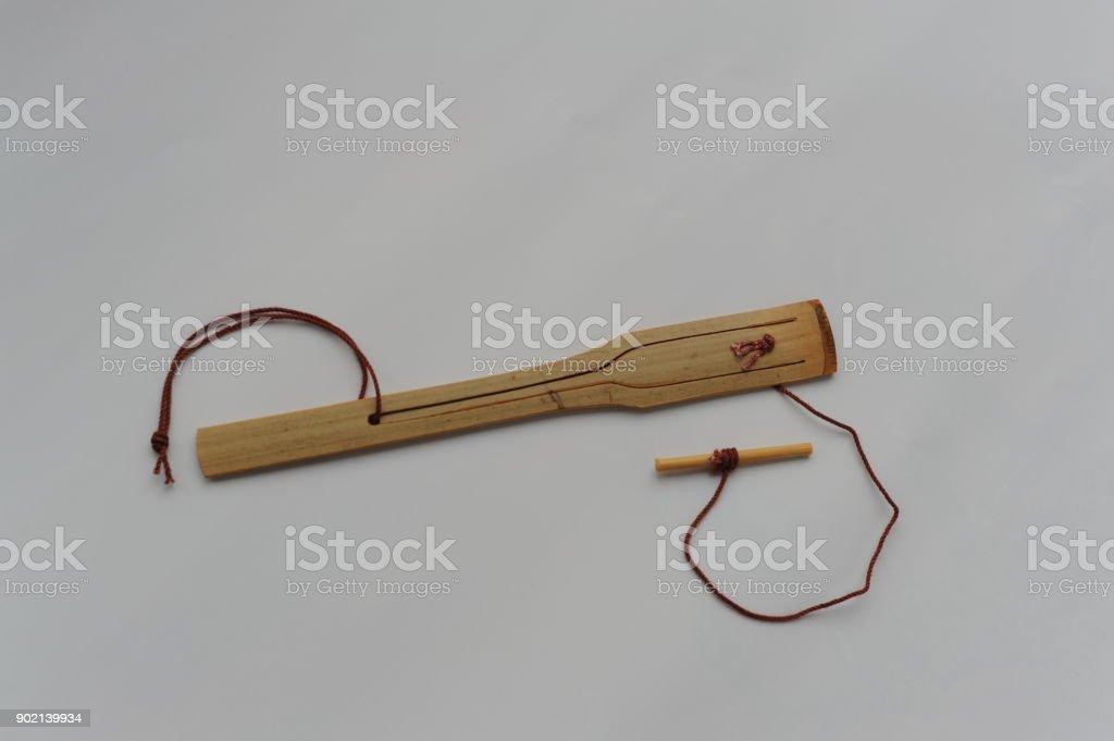 Mukkuri - a traditional Ainu musical instrument from Hokkaido, northern Japan made from bamboo, similar to jaw harp stock photo