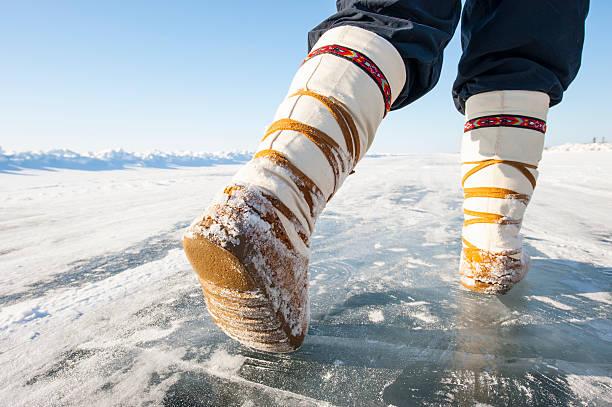 Mukluks on an Arctic Ice Road, Yellowknife, Northwest Territories, Canada. stock photo