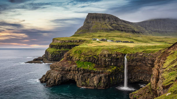 Mulafossur Waterfall Sunset Panorama Gasadalur Vágar Faroe Islands stock photo