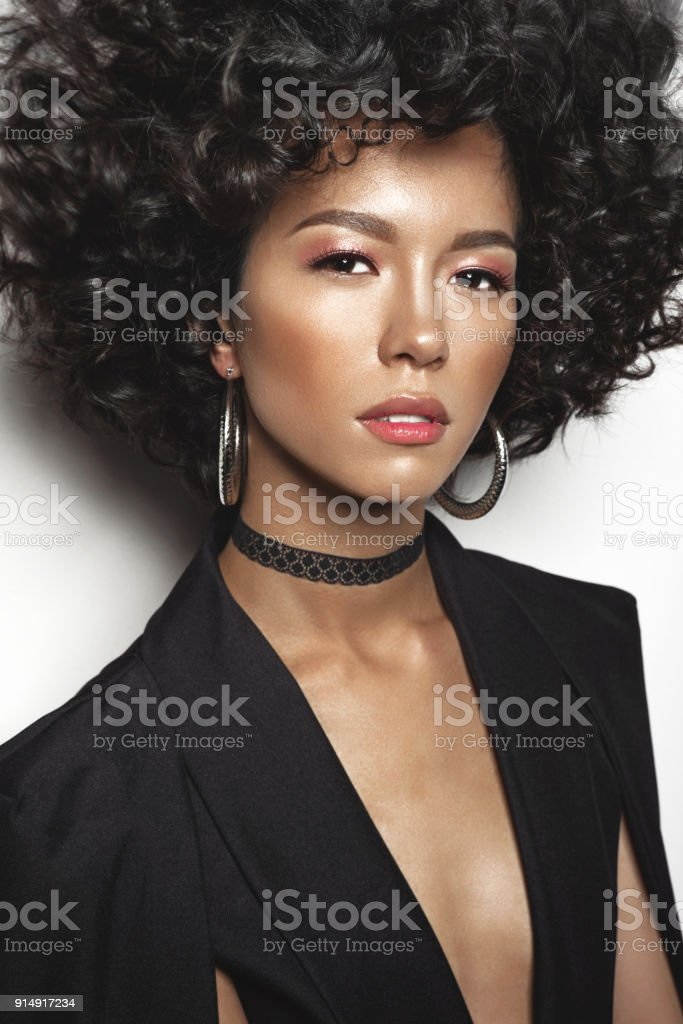 Mulatto woman with afro curls hairstyle stock photo