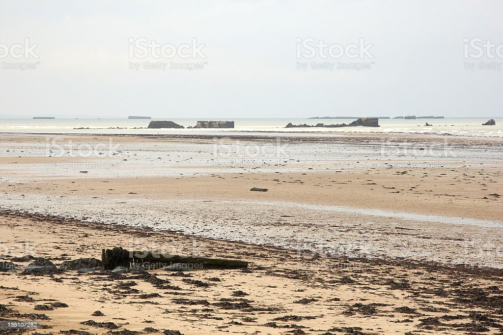Mulberry Harbours on WW2 beach royalty-free stock photo