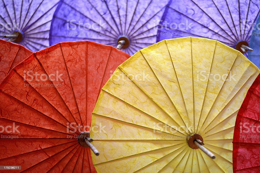 Mulberry umbrellas in Chiang Mai market, Thailand stock photo