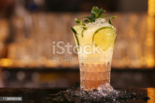 Mule alcohol cocktail drink with lime slice and mint leaves