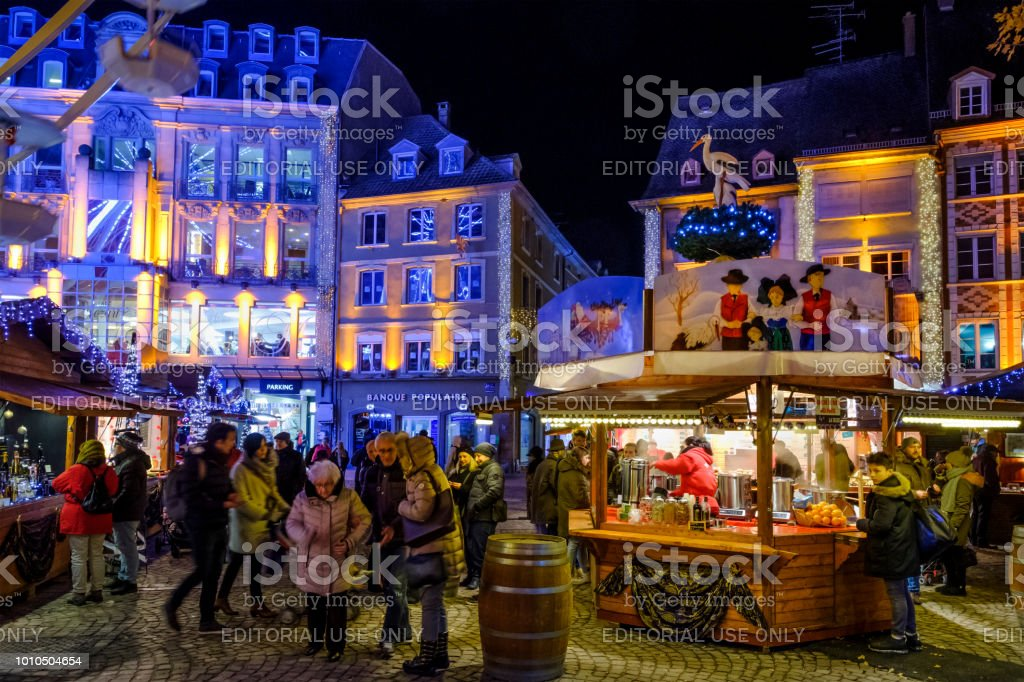 People at the traditional Christmas market in Place de la Réunion in...