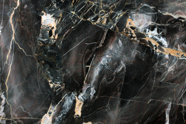 Mulicolored dark natural marble stock photo