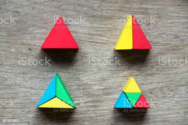 Mulit color toy block compound as triangle shape on wood background picture id827970622?b=1&k=6&m=827970622&s=612x612&h=7rtul2x2cdtvlgnhoz1mupg5ebxw6gj4vp1yet3ubkk=
