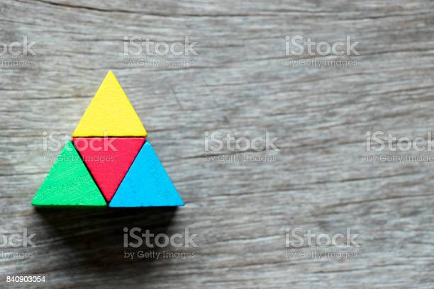 Mulit color toy block compound as triangle shape on wood background picture id840903054?b=1&k=6&m=840903054&s=612x612&h=abflf9in99ewghiiizgrkczju2b87mvgmczyssmfpdw=