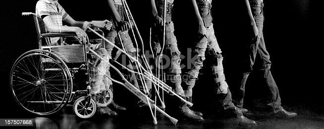 istock Mulitple Exposure of Patiient Progressing from Wheelchair to Walking 157507668