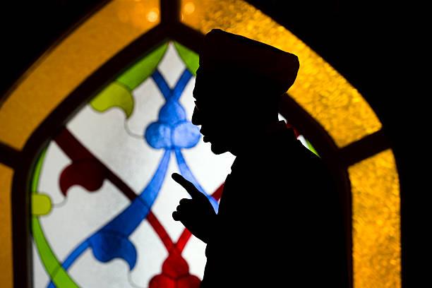 mullah prays stock photo