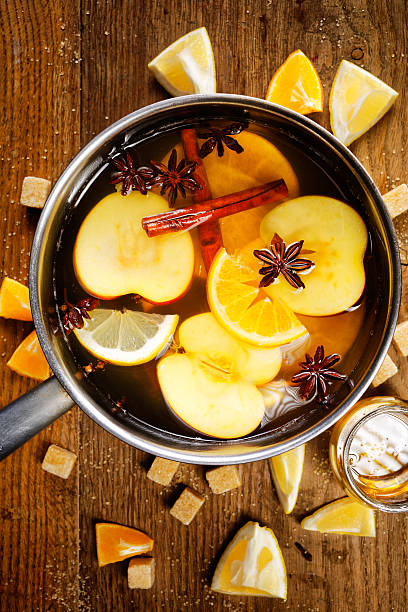 Mulled apple cider in a pot Components of mulled apple cider hot apple cider stock pictures, royalty-free photos & images