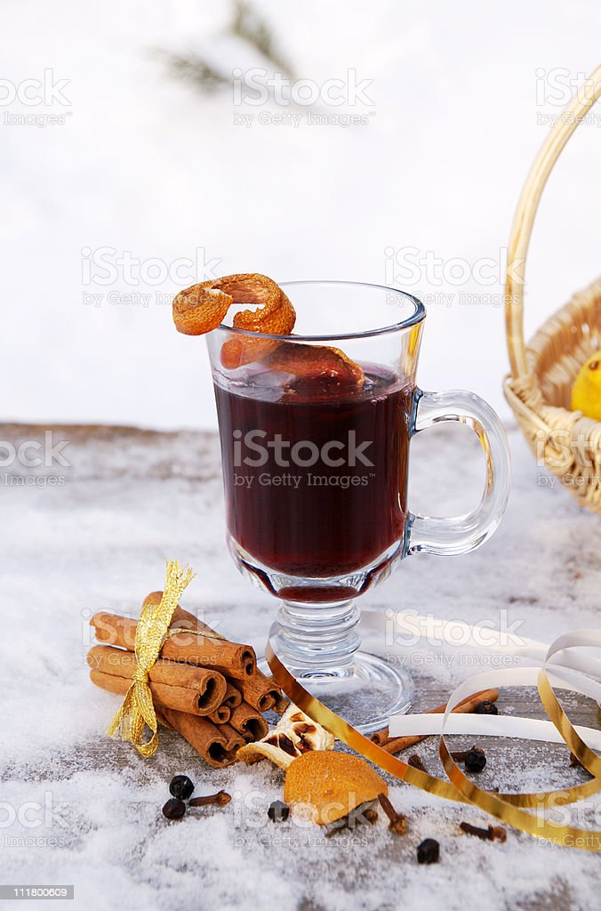 Mulled red wine on a snowy table outdoor in winter royalty-free stock photo