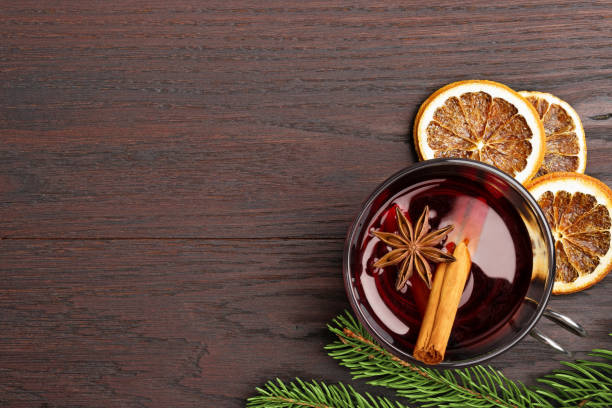mulled wine and decorations on wooden table - mulled wine stock photos and pictures