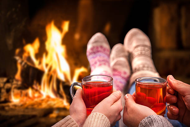 mulled wine at romantic fireplace - mulled wine stock photos and pictures