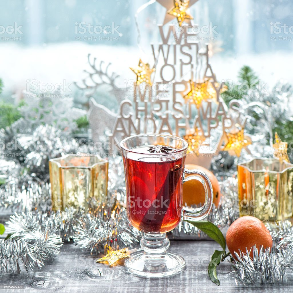 Mulled wine with Christmas window decoration. Winter food and drink