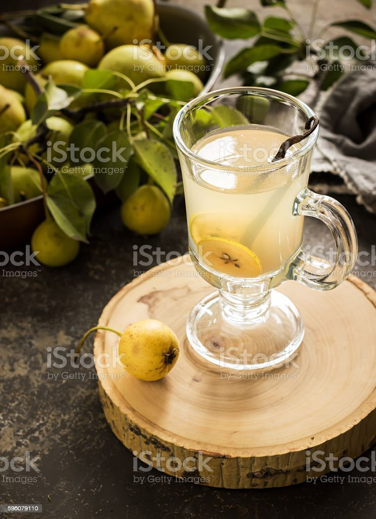 Mulled wine in glass and pears on background. royalty-free stock photo
