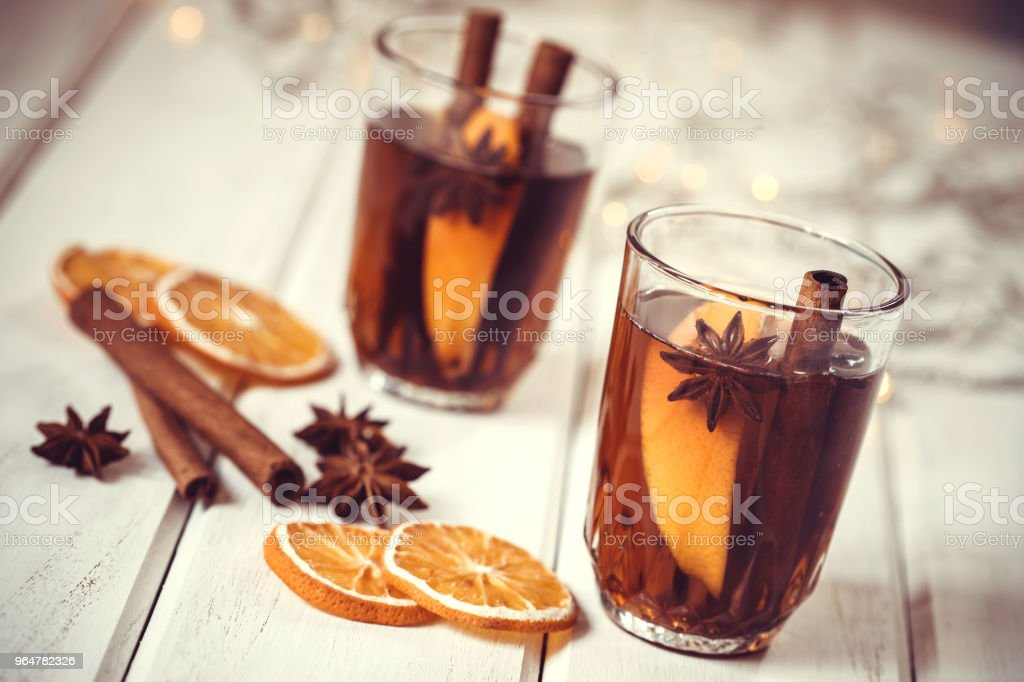 Mulled wine in night celebration of  New Year party and delicious Christmas drink for autumn and winter season royalty-free stock photo
