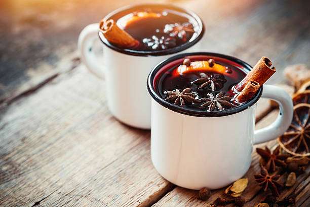 Mulled wine in white rustic mugs with spices stock photo