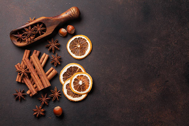Mulled wine ingredients spices. Anise, cinnamon and cardamom stock photo