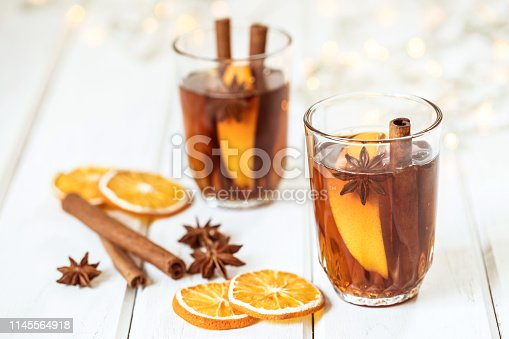istock Mulled wine on white table in night celebration of  New Year party and delicious Christmas drink 1145564918