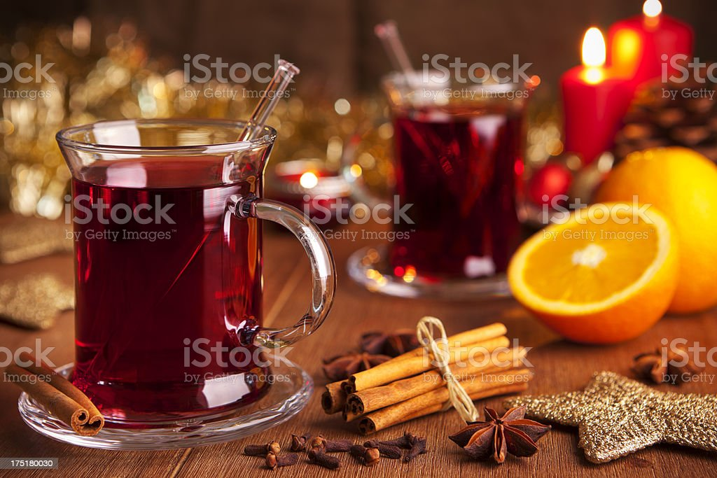 Mulled wine or glühwein on a rustic table royalty-free stock photo