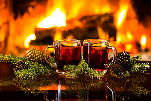 mulled wine or hot drink, christmas decoration, fireplace - mulled wine stock photos and pictures