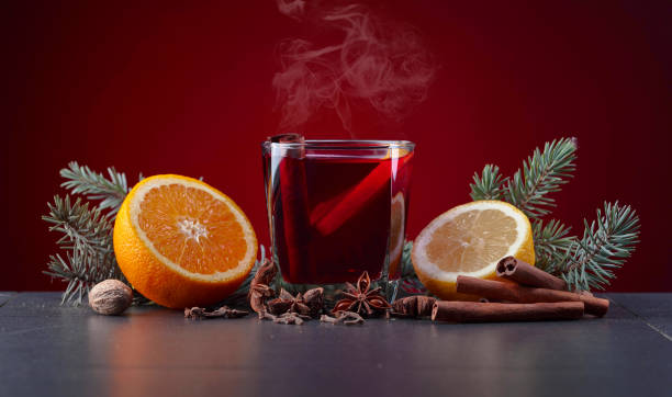 mulled wine with spices and citrus. - mulled wine stock photos and pictures