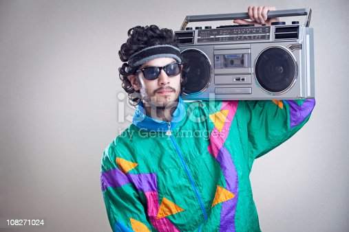 A cool, funky young hipster adult from the late 20th century complete with mullet, boom box