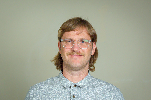 Happy man with mullet and glasses