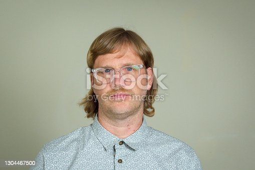 Man with mullet and glasses