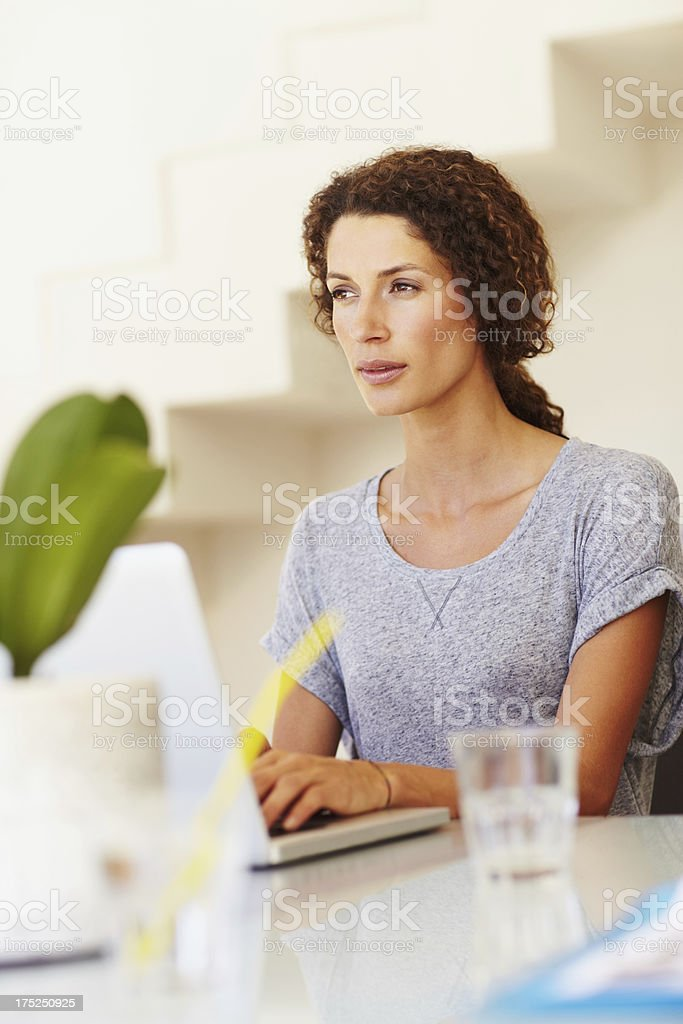 Mulling over her emails royalty-free stock photo