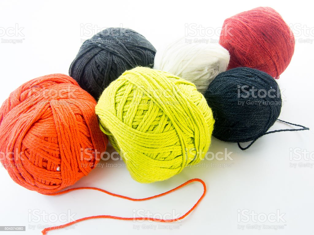 multi color balls of wool over white background stock photo