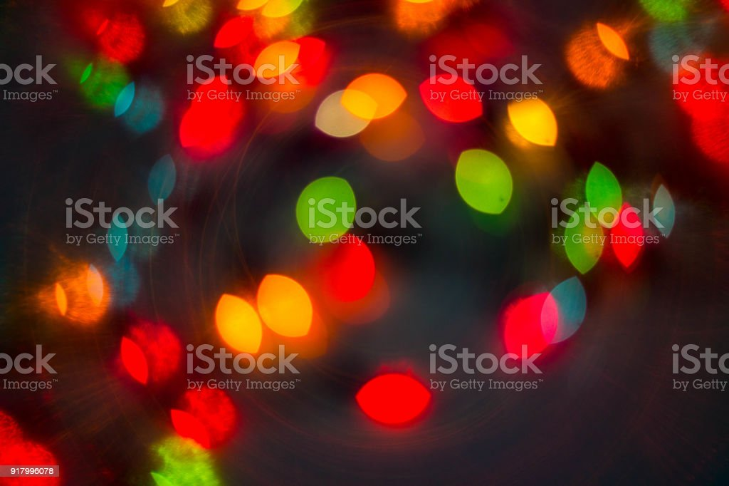 Multi color bokeh light. Defocused background.City night light blur...