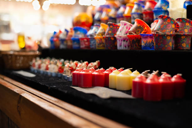 multi color candles at christmas market stock photo