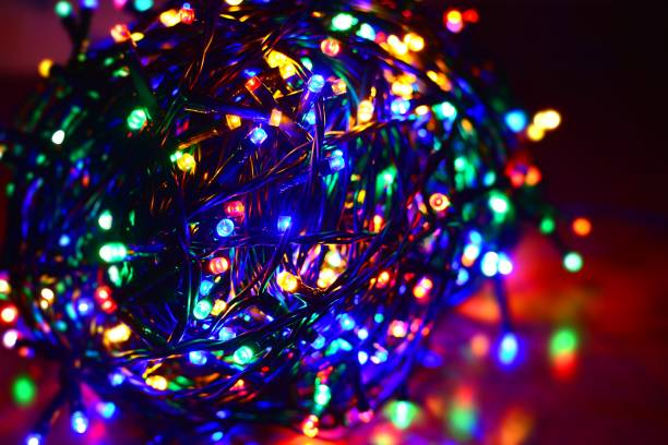 multi color led string - tangled stock photos and pictures