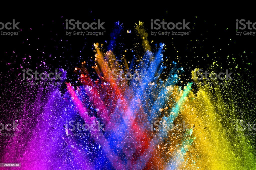 Multi color powder explosion isolated on black background. Colored dust splash cloud on black background. Launched colorful particles on background. Painted Holi. stock photo