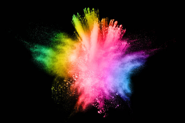 multi color powder explosion on black background. - colore descrittivo foto e immagini stock