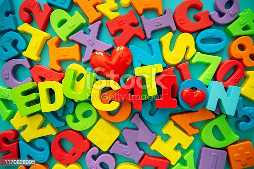 istock Multi colored alphabets ans number blocks background 1170628095