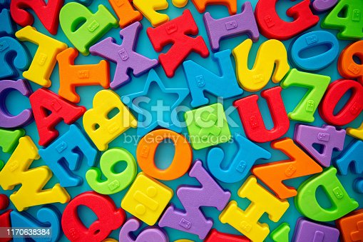 istock Multi colored alphabets ans number blocks background 1170638384