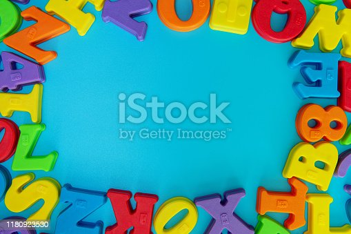 istock Multi colored alphabets frame background 1180923530