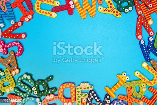 849182490 istock photo Multi colored alphabets frame background 1192655057