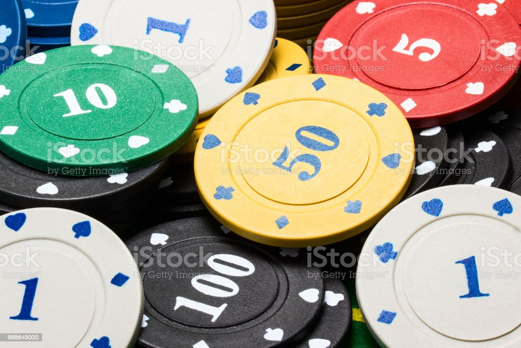 Multi Colored And Different In Value Poker Chips Closeup Stock