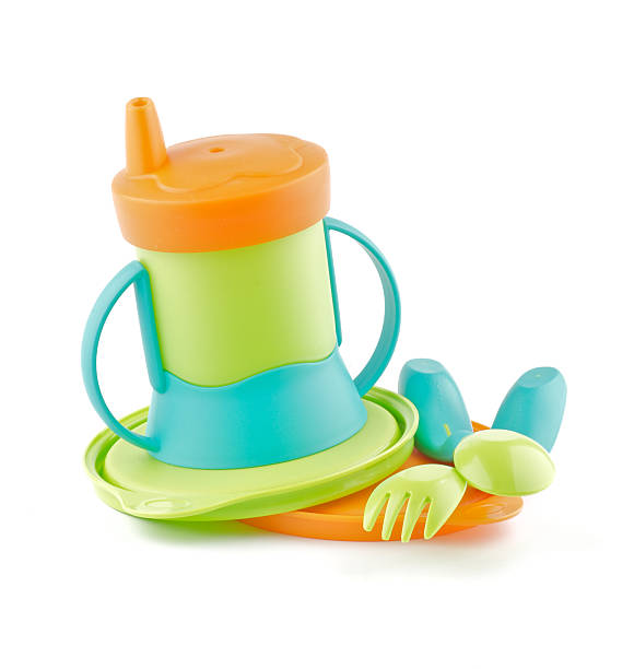 Multi Colored Baby Bottle and utensil stock photo