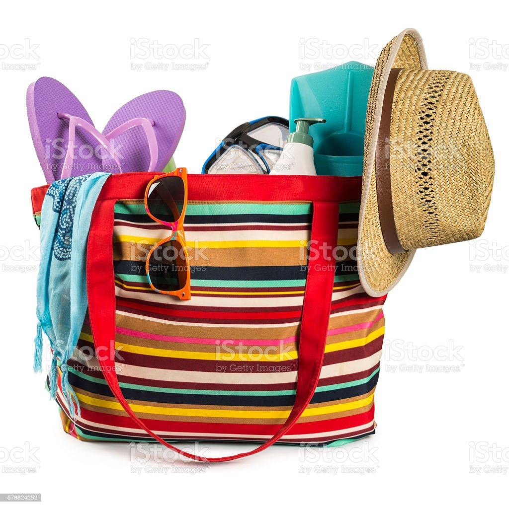 Multi colored beach bag with items isolated on white background stock photo